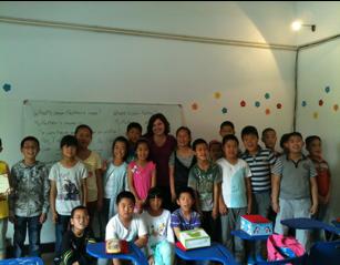 Lezioni di inglese ai bambini della campagna attorno a Tianjin